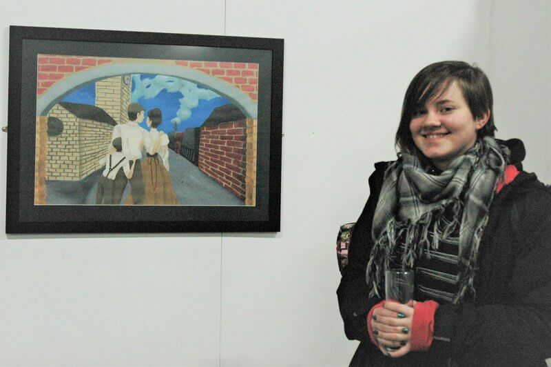 Barnsley College Art and Design student Rebecca Warburton with her artwork on display at Elsecar Heritage Centre.