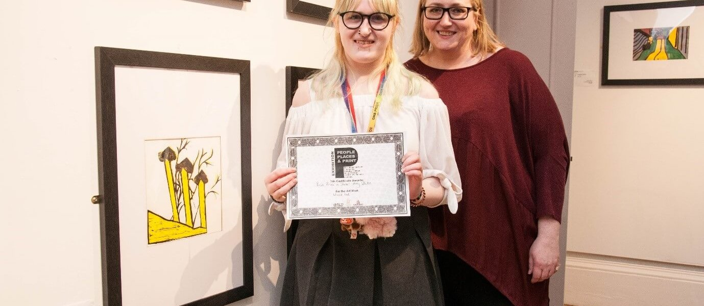 Barnsley College Art and Design student Amy White and Vice Principal Liz Leek at the People, Places and Print exhibition at the Cooper Gallery